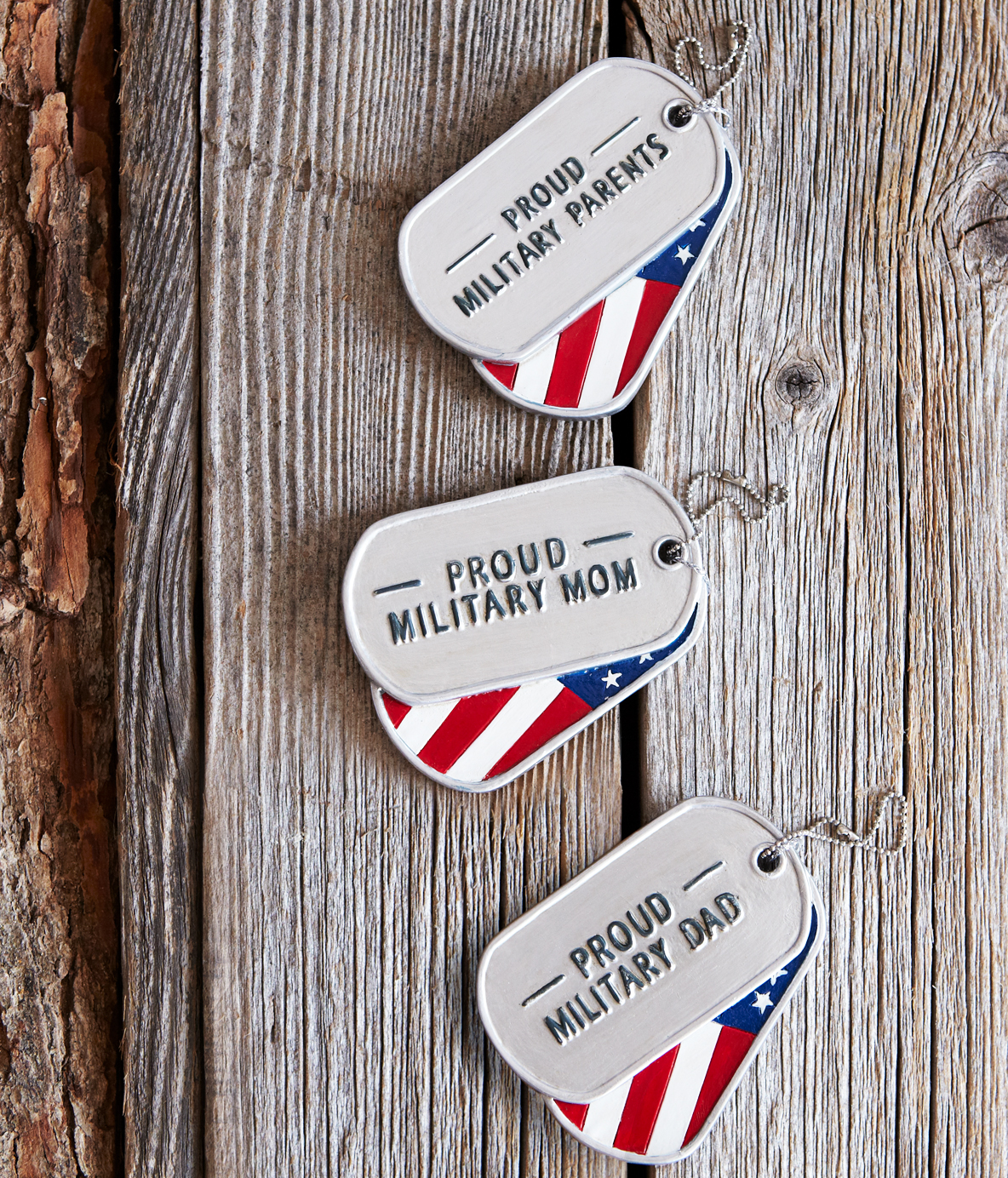 Styled shoot of Specialty Ornaments Military Dog Tag ornaments designed by Jacquelyn Arends; © Ganz/Midwest-CBK 2019
